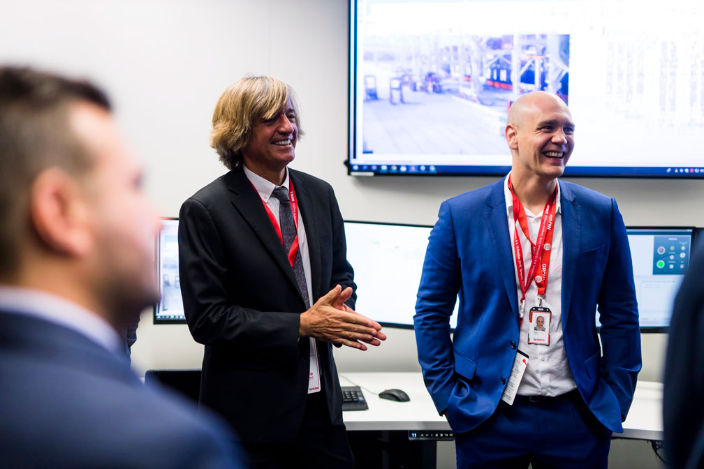 John Alvarez and Mika Seppä speaking together at Kalmar's Explore Automation 2019 event.